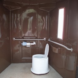 Interior_of_a_waterless_restroom_with_a_toilet_riser-250x250
